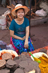 A young girl selling tortillas at the CENTRAL MARKET in KENGTUNG also known as KYAINGTONG  MYANMAR