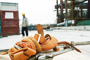 Construction site  close-up of safety harness lying on ground