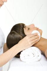 Woman having her make-up removed  using towel as a pillow  cropped view