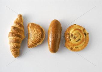 Pastries: croissant  apple turnover  bun  and raisin danish