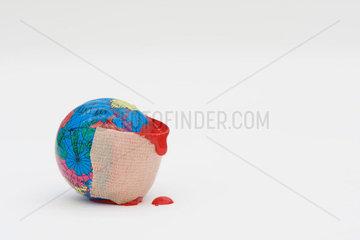 Adhesive bandage dripping blood wrapped around globe