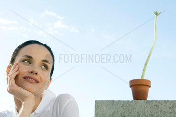 Woman with plant  smiling