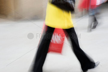 Pedestrian carrying shopping bag  cropped