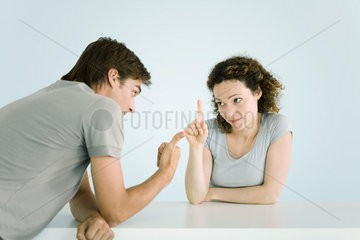 Couple arguing  making gestures  waist up