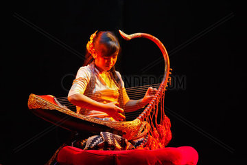 Traditional HARP MUSIC is performed at the MANDALAY MARIONETTES THEATER  MANDALAY  MYANMAR