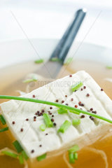 Block of tofu in miso soup  close-up