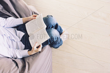Boy reading book  cropped