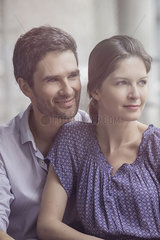 Couple sitting together  looking away  portrait