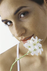 Young woman holding white flowers  portrait