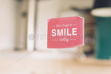 Sticker bearing the message Don't forget to smile today