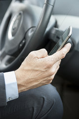 Cell phones can be dangerous distractions while driving