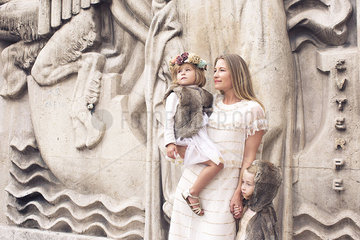 Mother and daughters together outdoors