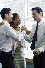 Businessmen congratulating each other