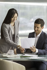 Business professionals reviewing agreement together