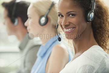Woman working in call center  smiling cheerfully
