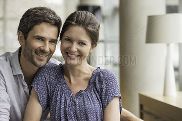Couple smiling together at home  portrait