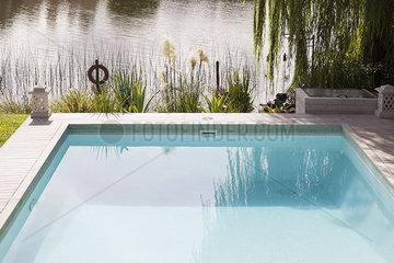 Swimming pool on edge of lake