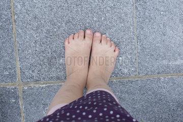 Little girl's bare feet  overhead view