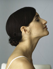 Woman with chignon  eyes closed  profile