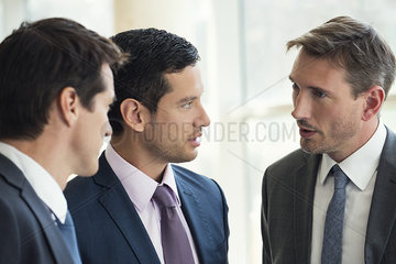 Businessmen talking together