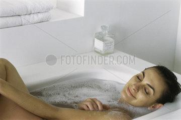 Woman relaxing in bubble bath  eyes closed