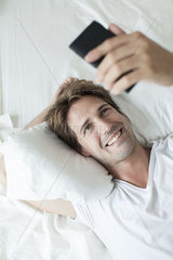 Man video conferencing on smartphone