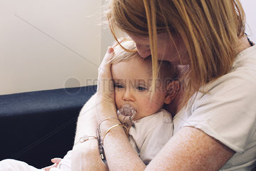 Mother holding infant on lap