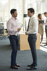 Businessmen chatting
