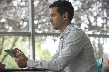 Man using digital tablet  side view