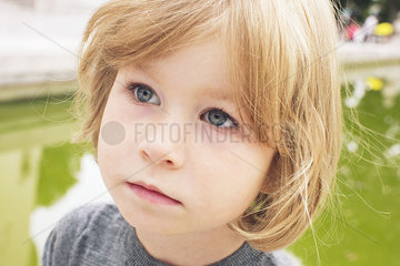 Little girl looking away in thought  portrait