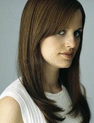Brunette woman looking sideways at camera  portrait