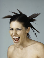 Woman with spiky hairdo  mouth wide open