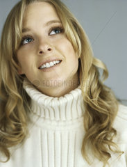 Teenage girl looking up in thought  portrait