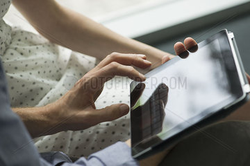 Couple using digital tablet  close-up