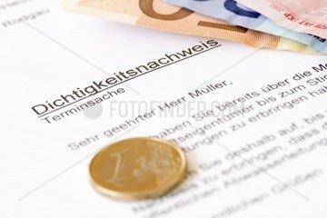 Brief mit Betreff Dichtigkeitsnachweis und Euro-Muenze
