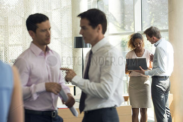 Business associates in animated conversation