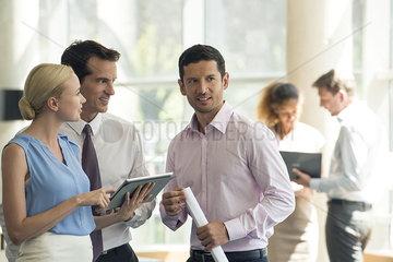 Professionals collaborating using digital tablet