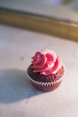Cupcake decorated with pink frosting