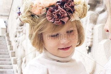 Little girl wearing flower wreath  portrait