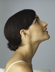 Woman looking up  smiling  profile