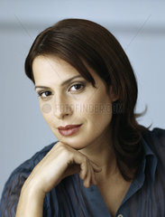 Woman resting chin on hand  portrait