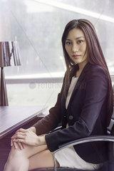 Business woman at desk  portrait