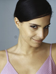 Woman smiling slyly at camera  portrait