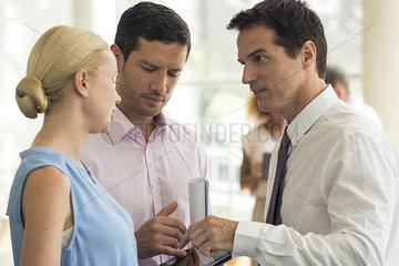 Businessman explaining position to colleagues