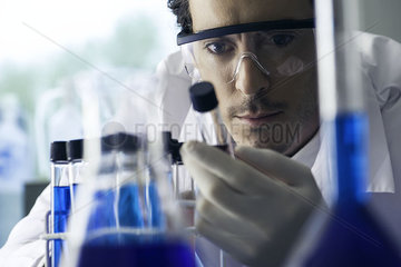 Lab technician conducting experiment in laboratory
