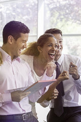 Office workers sharing lighthearted moment together