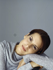 Woman resting head on arms  portrait