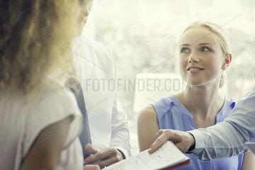 Associate handing colleague document