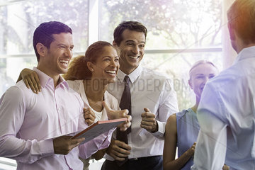 Business associates sharing lighthearted moment together