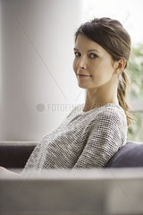 Woman relaxing on sofa  portrait